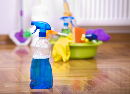 spray bottle: Close up of spray bottle for floor cleaning with different cleaning supplies and equipment in background