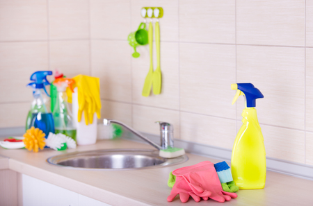 countertop: Spray bottle and cleaning tools on the kitchen countertop Stock Photo