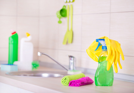 spray bottle: Spray bottle and cleaning tools on the kitchen countertop Stock Photo