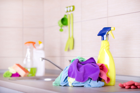 spray bottle: Spray bottle and cleaning cloths on the kitchen countertop Stock Photo