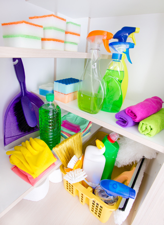 cleaning supplies: Cleaning supplies and tools arranged on shelves in pantry