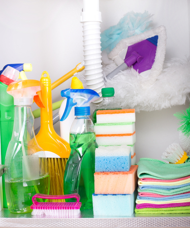 cleaning supplies: Set of cleaning supplies and equipment in sink cabinet in kitchen Stock Photo