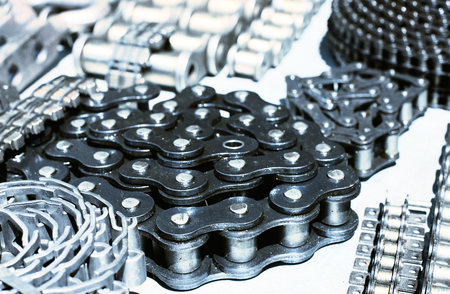 torque: Close up of rolled new motor chains Stock Photo