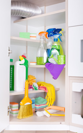 cleaning supplies: Cleaning supplies and tools stored on shelves in storage place