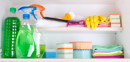 pantry: Cleaning supplies and tools arranged on shelves in pantry