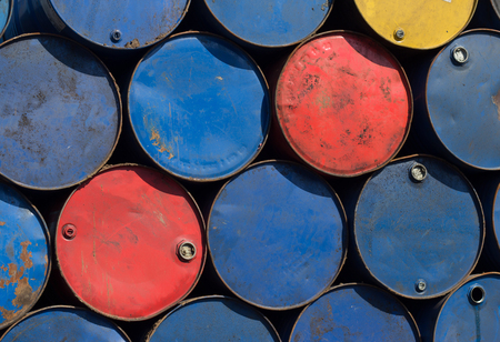 scrapyard: Oil barrels or chemical steel drums stacked on scrapyard Stock Photo