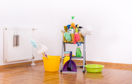 keeping room: Cleaning supplies and equipment on ladder on parquet in the corrner of the room Stock Photo