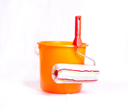 Roller brush and bucket for painting wall isolated on background Stock Photo