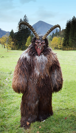 crone: Man wearing traditional Krampus beast-like mask from Alpine region Stock Photo