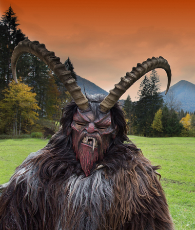 Man wearing traditional Krampus beast-like mask from Alpine region Stock Photo