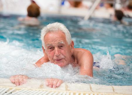 spa and resort: Senior man resting in jacuzzi in spa resort
