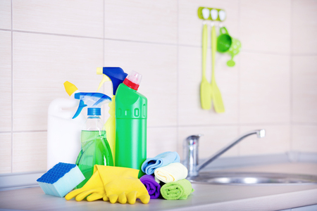 Cleaning sypplies and tools on the kitchen countertop Stock Photo