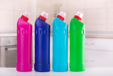 Close Up Of Group Of Colorful Cleaning Supplies On White Table ...