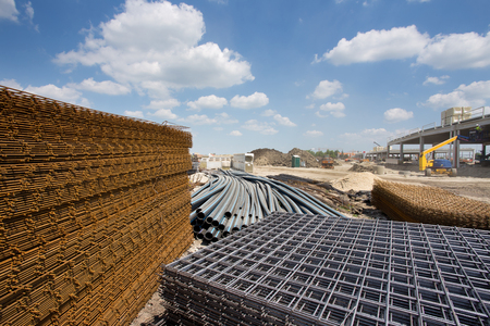 reinforcement: Close up of reinforcement mesh on pile and other construction material and equipment at building site Stock Photo