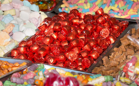 bonbons: Close up of various candies and confectionery on pile for sale