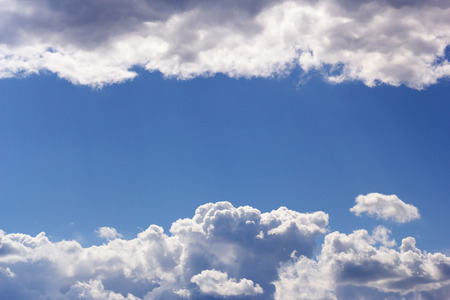 Blue sky with white clouds as background. Space for your text