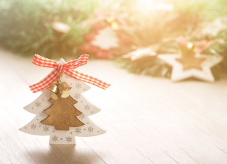Close up of Xmas tree decoration on wooden table. Christmas holiday and New Year concept