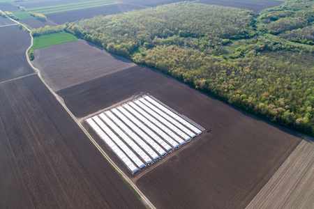 Aerial image of greenhouses in plains shoot from drone