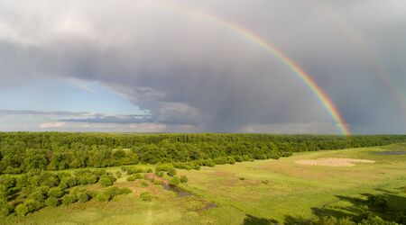 Aerial image of beautiful wild landscape shoot from drone with two rainbows on dramatic sky 版權商用圖片