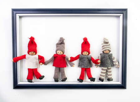 Funny christmas dwarfs in image frame on white background