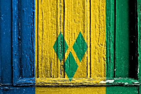 grenadines: flag of Saint Vincent and the Grenadines painted on wooden frame