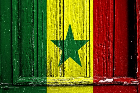 flag of Senegal painted on wooden frame photo