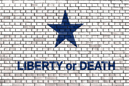 patriotic martyr: slogan Liberty or Death on a brick wall