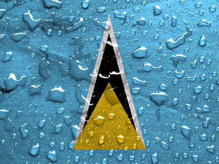 saint lucia: flag of Saint Lucia with rain drops