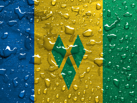 grenadines: flag of Saint Vincent and the Grenadines with rain drops Stock Photo