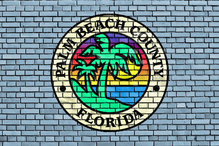 flag of Palm Beach County painted on brick wall