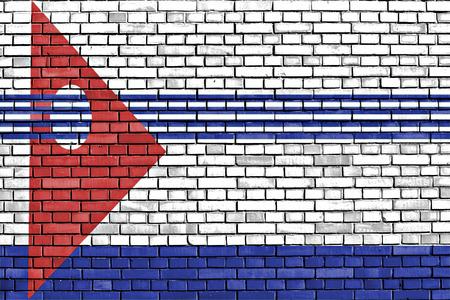 artigas: flag of Artigas Department painted on brick wall Stock Photo