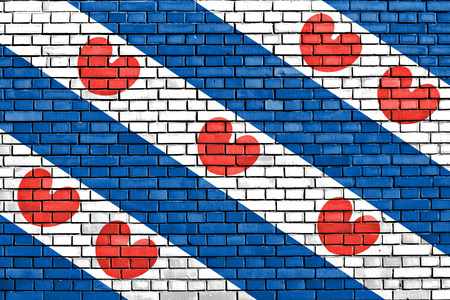 flag of Friesland painted on brick wall