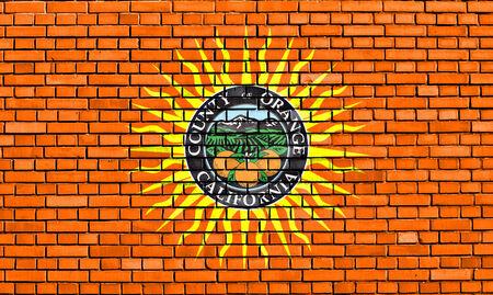 orange county: flag of Orange County painted on brick wall