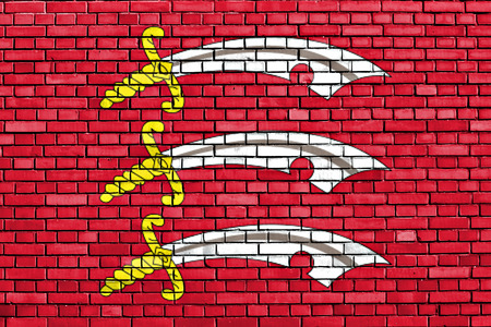 flag of Essex painted on brick wall
