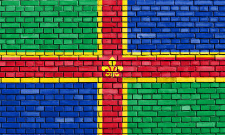 flag of Lincolnshire painted on brick wall