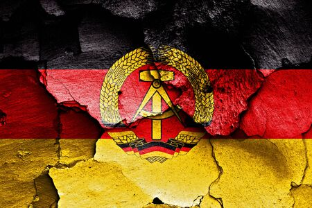 flag of East Germany painted on cracked wall photo