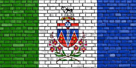 yukon: flag of Yukon painted on brick wall Stock Photo