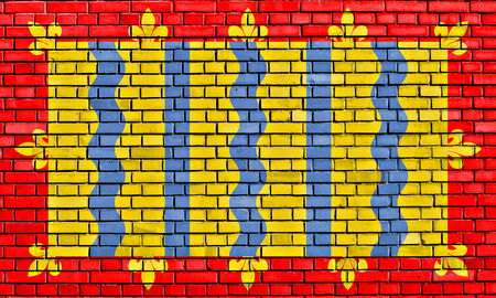 cambridgeshire: flag of Cambridgeshire painted on brick wall