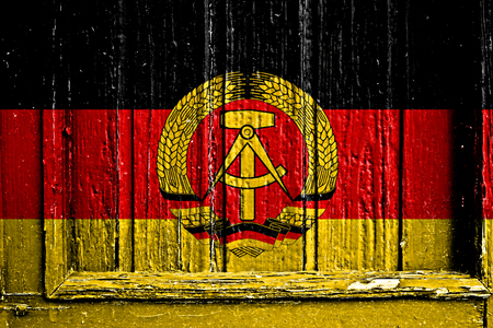 east of germany: flag of East Germany painted on wooden frame Stock Photo