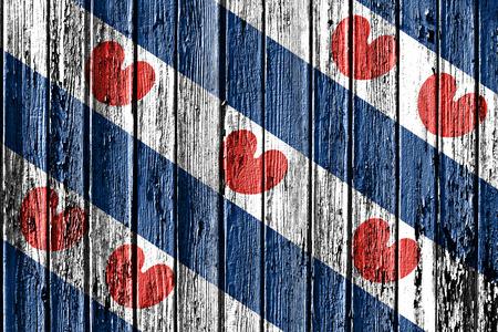 flag of Friesland painted on wooden frame