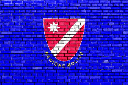 molise: flag of Molise painted on brick wall Stock Photo