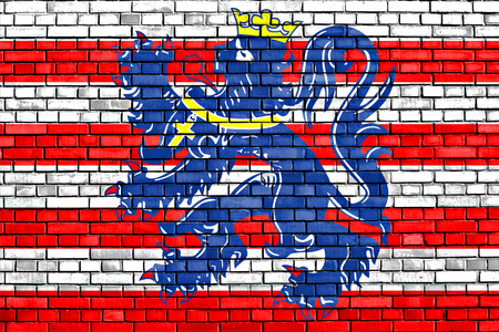 bruges: flag of Bruges painted on brick wall Stock Photo