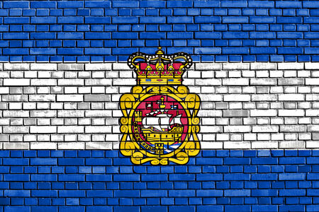 aviles: flag of Aviles painted on brick wall