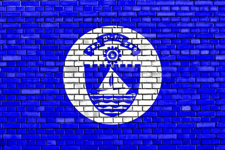 yam israel: flag of Bat Yam painted on brick wall