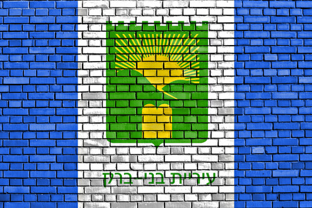 bene: flag of Bnei Brak painted on brick wall