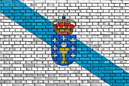 flag of Galicia painted on brick wall Stock Photo