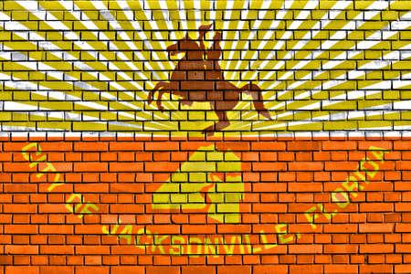 jacksonville: flag of Jacksonville painted on brick wall