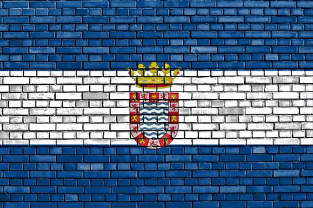 flag of Jerez painted on brick wall