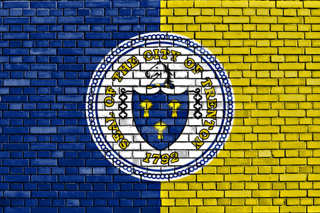 flag of Trenton painted on brick wall