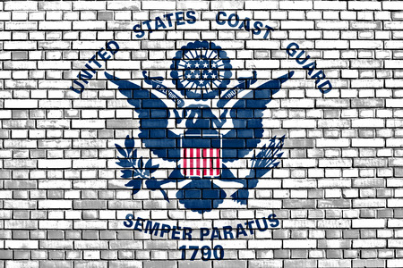 flag of United States Coast Guard painted on brick wall